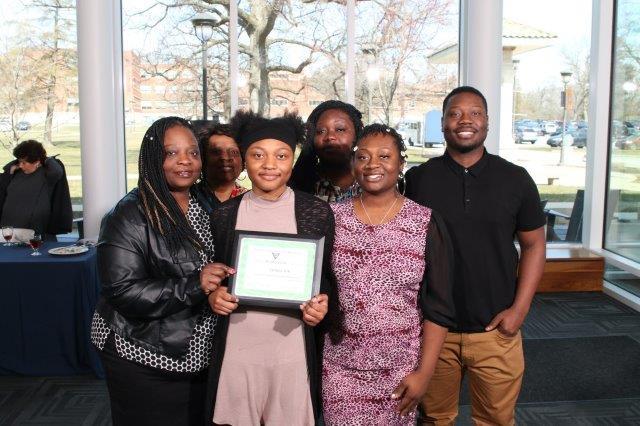 Essay winner and her family
