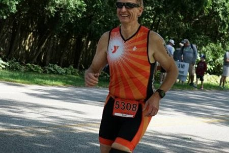 Scott running during a Triathlon.