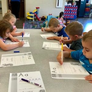 Preschoolers working on their letters