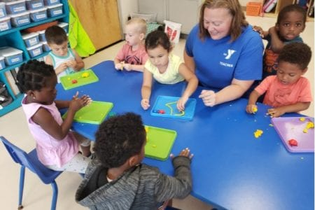 Miss Lisa interacts with preschool children