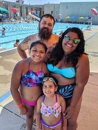 Hinton family enjoying the outdoor pool