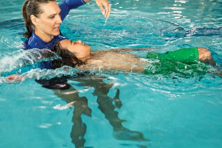 Private Swim Lesson image with instructor and boy