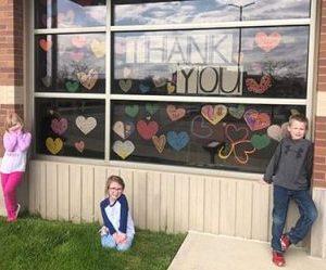 Children standing outside the YMCA - Communities