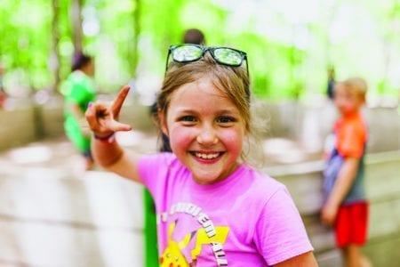 young girl showing a peace sign - Mission