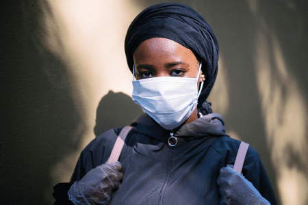 female wearing COVID mask