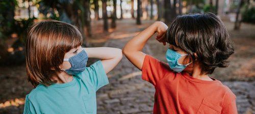 Kids Need Camp - boys touching elbows
