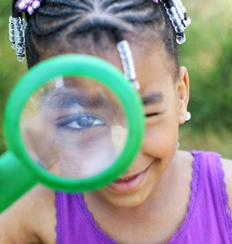 Kids Need Camp - Girl with magnifying glass