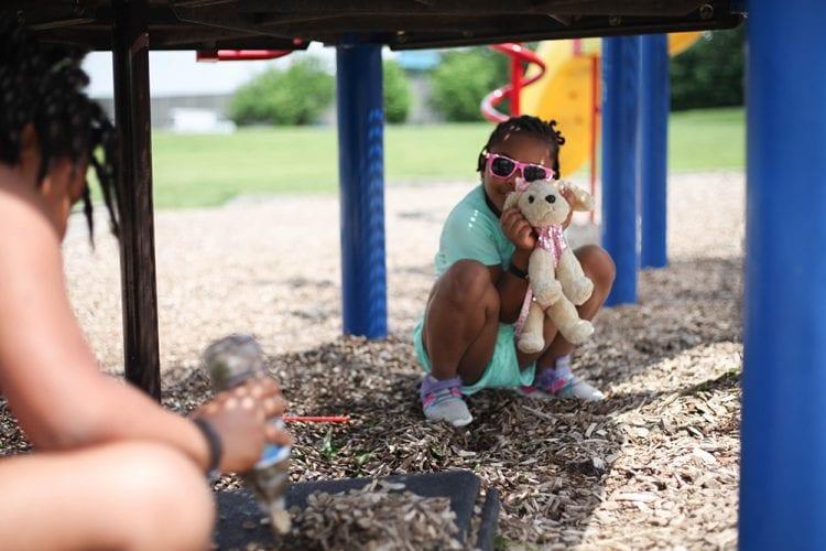 Girls under playground equipment